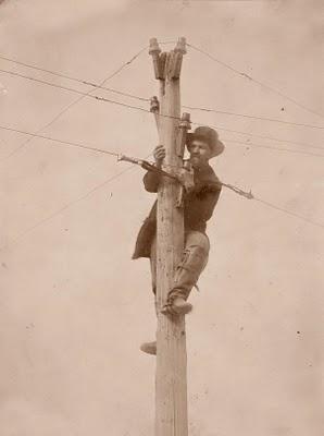 Worker repairing a telegraph pole, 1862